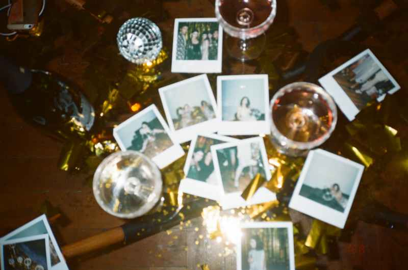 wine glasses and pictures on table